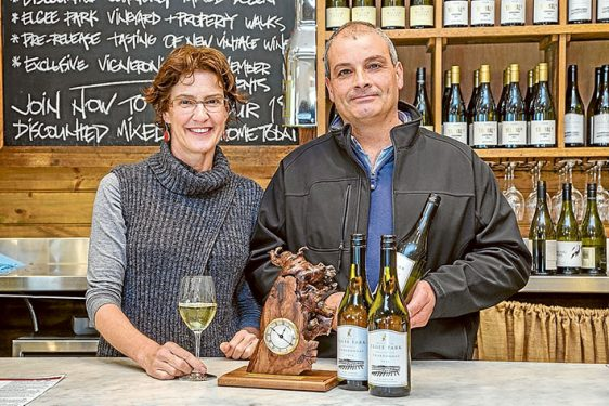 Peninsula Wine Show Winners. Photo: L-R Judy Gifford and Laurence Tedesco inside Merricks General Store with his winning wine.