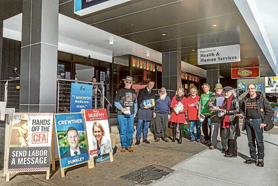 The home straight: Liberal candidate Chris Crewther, Labor candidate Peta Murphy and other political parties hand out flyers to early voters in Dunkley. Picture: Gary Sissons