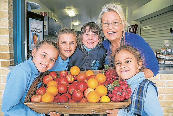 Yum yum: Canteen manager Mandy Biggins, herewith Francesca, Lilka, Brigitte and Saskia, says Kunyung pupils look forward to meal times now.                Picture: Gary Sissons
