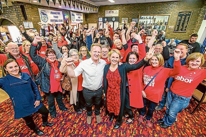 The swing is in: Labor supporters including Peta Murphy, front centre, and Labor state MPs Paul Edbrooke and Sonya Kilkenny all smiles at an election night party event at Pines Football Club. Picture: Gary Sissons