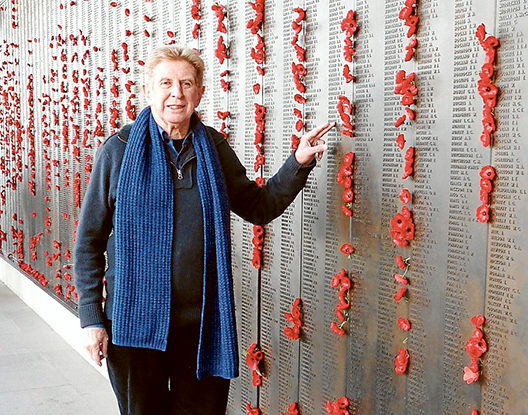Coming 'home': Peter Munro by the Rolls of Honour at the Australian War Memorial Canberra. The 188 panels contain the names of 61,000 Australian Soldiers killed in WWI. Among the names are the 13 Sorrento soldiers who served, including William Brumby, top, and Albert Hibbert.
