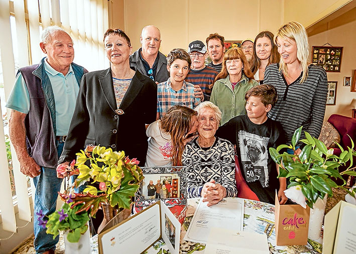 Many happy returns: Rosebud's Thelma Appleford celebrates her 100th birthday with her brood: Gary, Jeannette, Geoff, Don, Sean, Eric, Mikaela, Bianca, Sam, Sue, Stella (kissing her), and Nick. Picture: Yanni