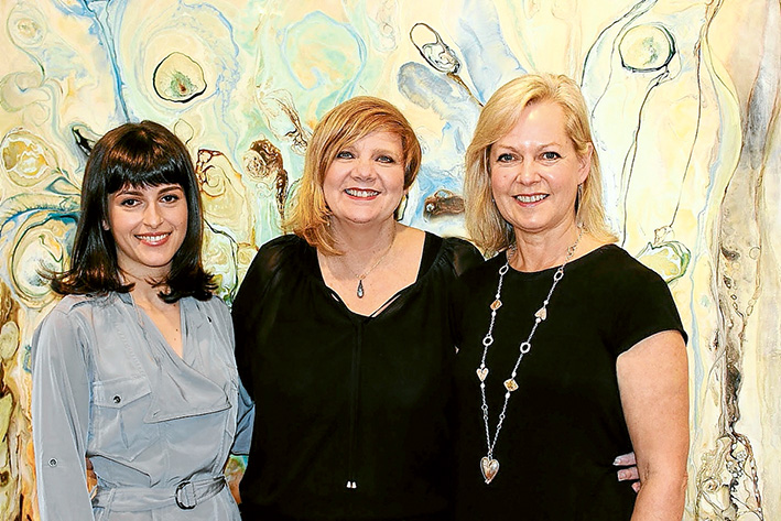 """Arts inspired: Manyung Gallery has moved and expended, with """"boutique"""" gallery at Mt Eliza Village, one for larger pieces at Mornington and spaces at Malvern and Sorrento. Working with the exhibitions are, from left, Irina Agaronyan (Malvern), co-director Sharyn Wemyss-Smith and Gillian Haig (Mt Eliza). Picture: Supplied"""