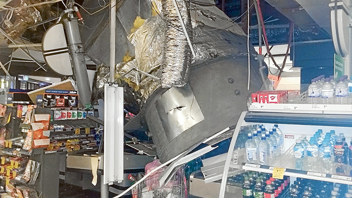 Down and out: The half tonne air conditioner which crashed into the near-empty Woolworths store at Mornington and, below, the blades of the fan which may have caused the collapse. Pictures: Gary Bryant