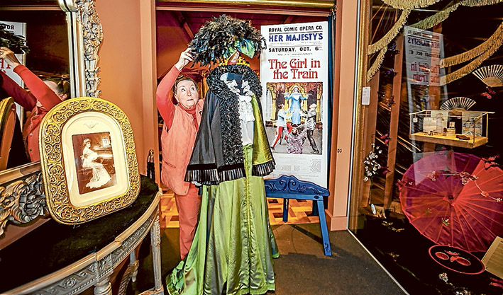 Memories: Costume mistress Heather Peake shows off some of the period fashions on show at the Beleura musical. Picture: Yanni