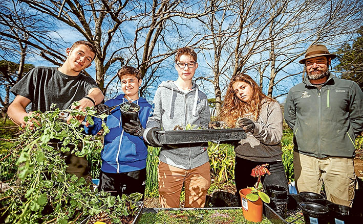 Cultural ties: The Briars hosted six French teenagers, among them Ninon Martin, Paul Pelletier, Slanislas (Stan) Brung and Romain Christophe, keen to help senior ranger Jarrod Ruche. Picture: Yanni