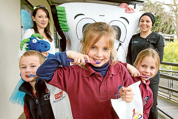 Healthy teeth message: The Tooth Fairy, Lola the Molar and oral health therapist Hafize Coskun; front pupils Max, Evie and Ella. Picture: Gary Sissons