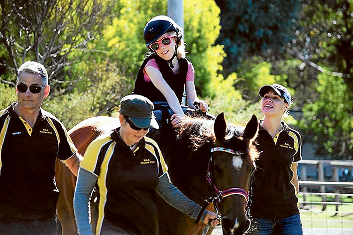Along for the ride: Hayley Bennetts, 12, enjoying time in the saddle at a Riding for the Disabled Western Port ride.