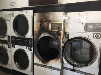 The fire-damaged dryer.