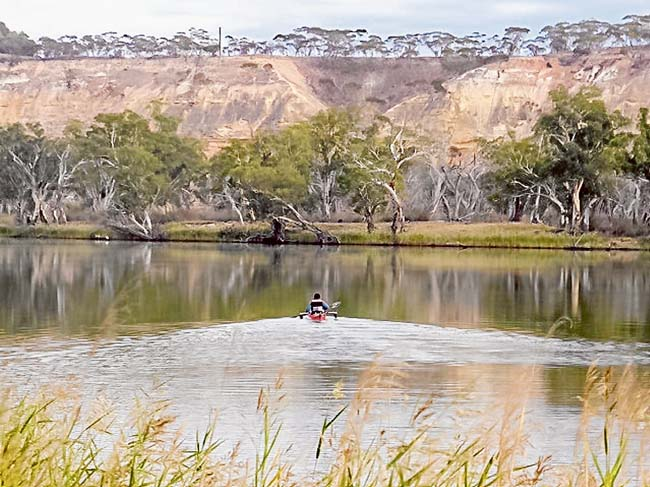 All aboard: Quadraplegic Dave Jacka kayaked 2226 kilometres down the Murray with the help of friends and an electronic device from Solve, a disability support group.