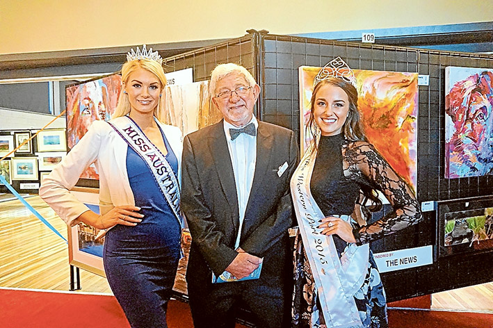 Art event: Miss Australia International Jessica Martini and Miss Westernport Mikaela Fowler join art show chair John Renowden at last year's opening.