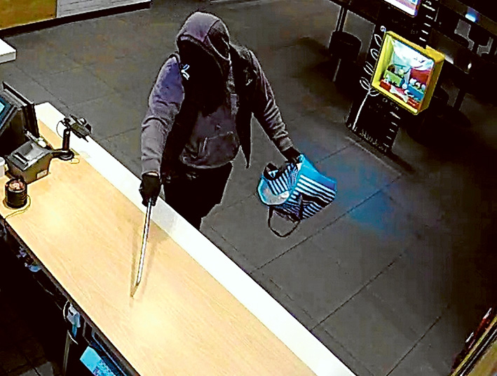Armed robberies: CCTV images of one of two men police are seeking.