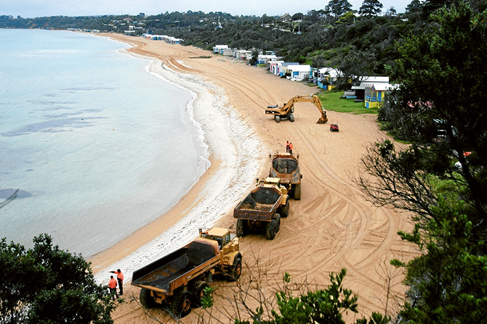 Sands of time: In April 2010 tonnes of sand were trucked along the beach from Mt Martha South to the severly eroded Mt Martha North. Mornington Peninsula Shire and the state government are about to spend $55,000 on another study into the best ways of managing and protecting the area. Picture: Keith Platt