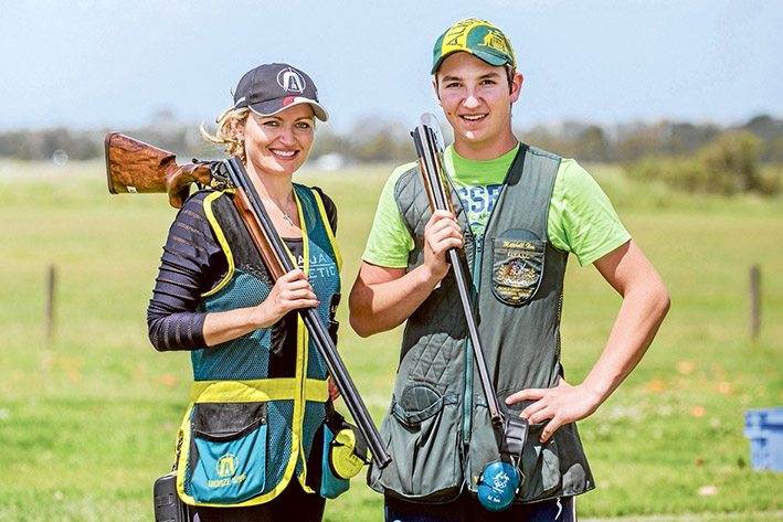 Top guns: Women's world champion Anna Shedrina and junior men's world champion Mitchell Iles competed in the first of four qualifying events at Frankston Clay Target Club last weekend. Picture: Gary Sissons
