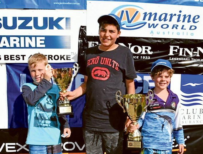 Junior Victorian Amateur Snapper Champion Hunter Blackford, of Frankston, right. Brodie King, of Manor Lakes, and Tommy Porto, of Baxter, share their runners-up cup after dead-heating. Pictures: Supplied and Gary Sissons